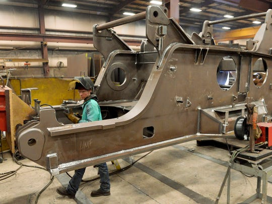 Welder Cody Schamburek manufactures a rotating bed for Manitowoc Cranes Model 999 at Heavy Metal Fabricators in Manitowoc.