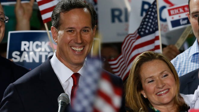 Rick Santorum stands with his wife, Karen, as he announces his candidacy for the Republican presidential nomination on May 27, 2015, in Cabot, Pa.