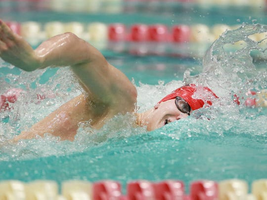 Waukesha South/Catholic Memorial's John Acevedo swims