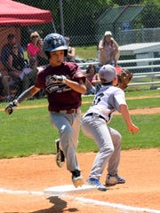 Action from the Elmira 12-under team Sunday at the
