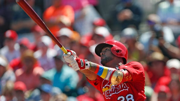 St. Louis Cardinals first baseman Jose Martinez (38) follows through on a home run in the fourth inning of a spring training baseball game against the Washington Nationals, Sunday, March 18, 2018, in Jupiter, Fla. (AP Photo/John Bazemore)
