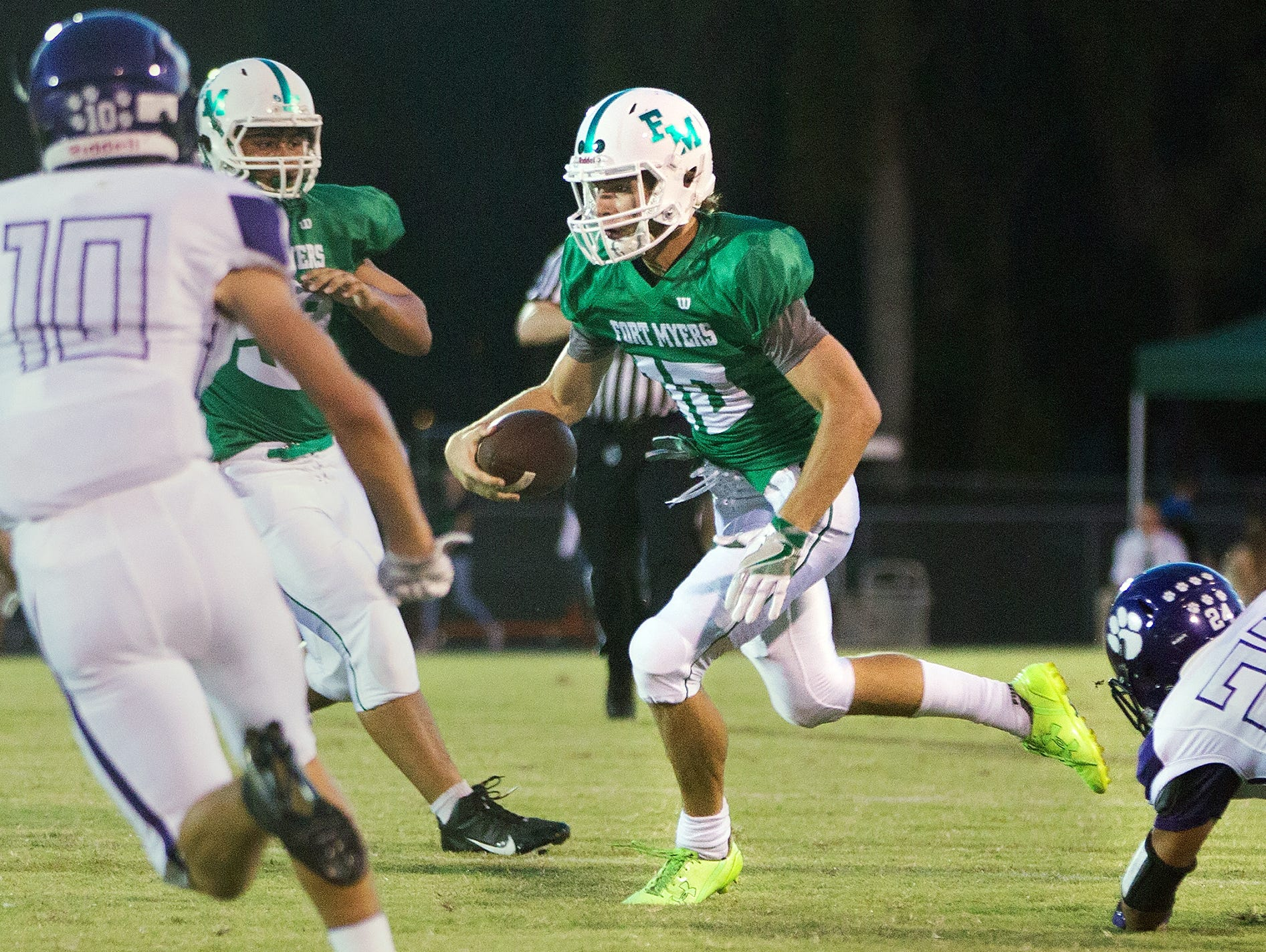 Fort Myers High School's Ben Stobaugh picks up a first down against Cypress Lake recently at Fort Myers High School.