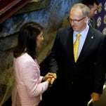 South Carolina Governor Nikki Haley shakes hands with Greg Sankey, commissioner of the SEC,  before a press conference at the Bon Secours Wellness Arena where it was announced that the SEC Women's basketball tournament will held at the arena next year.