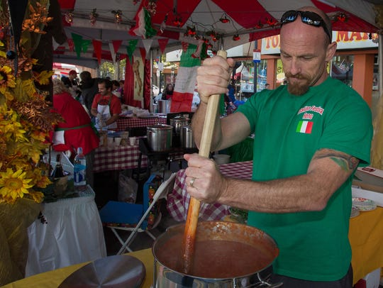 Stirring pasta sauce in the Alessi-Artana booth during