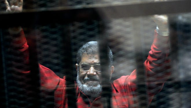 An Egyptian court on Saturday sentenced six people, including two Al-Jazeera employees, to death for allegedly passing documents related to national security to Qatar and the Doha-based TV network during the rule of Islamist president Mohammed Morsi.