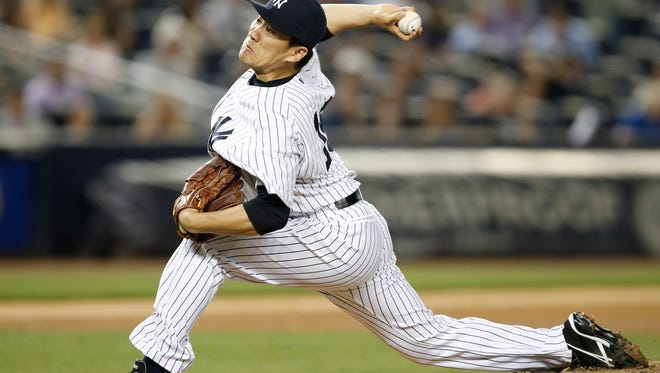 Yankees starting pitcher Masahiro Tanaka delivers in the sixth inning of Tuesday night's game against the Toronto Blue Jays at Yankee Stadium.