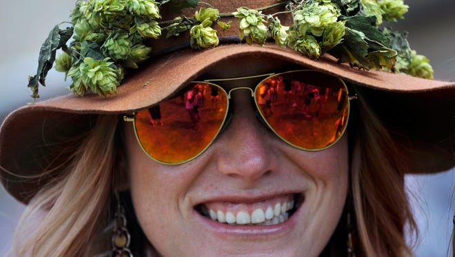 Christie Callahan of Abilene fended-off the hot sun Saturday at the Abilene Beer Summit wearing a hat decorated with hops. Craft brews, food and music were offered at the annual event Saturday Sept. 23, 2017, which was held on the Frontier Texas! parade ground.