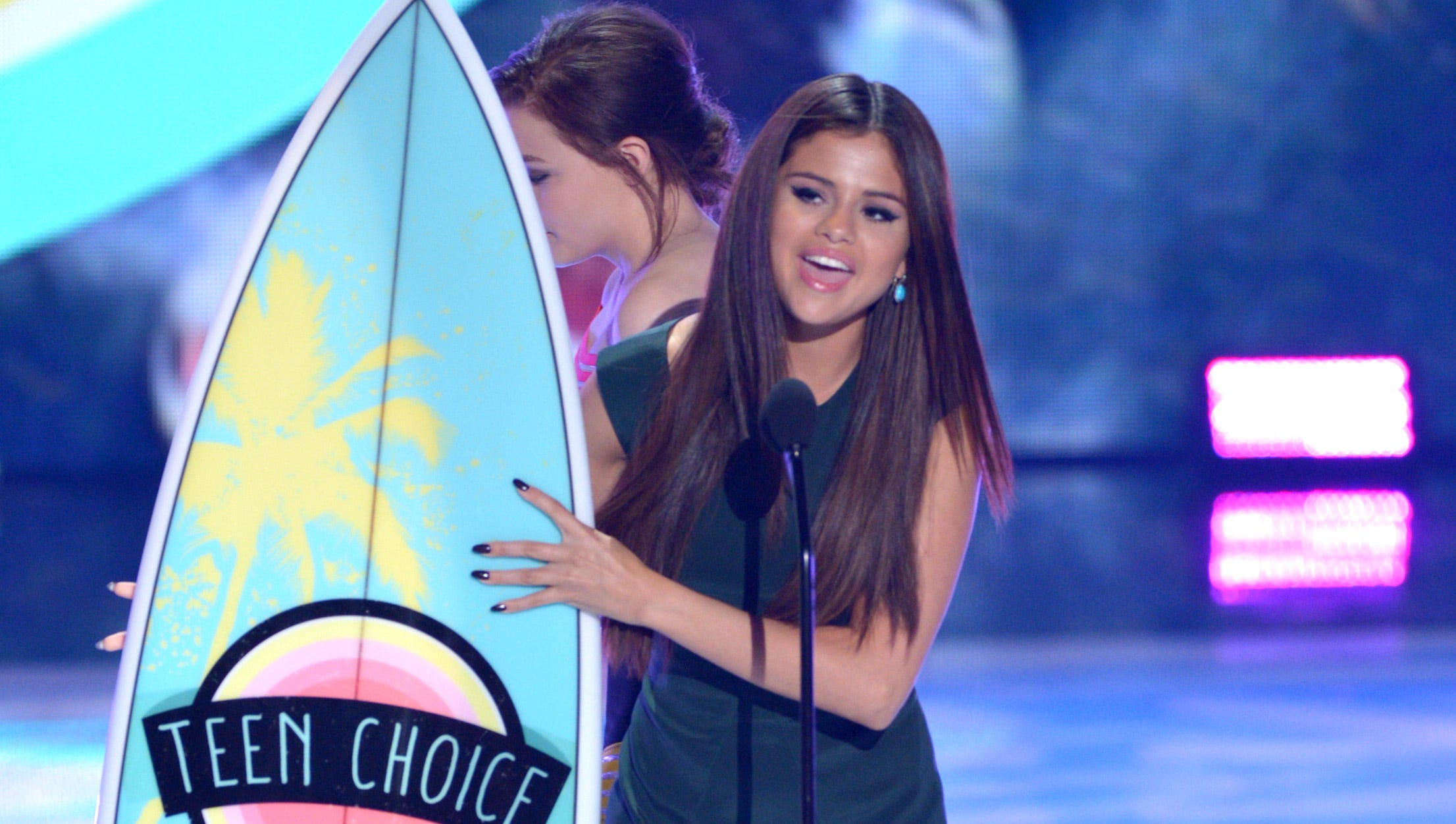"""Actress/singer Selena Gomez accepts the award for Choice Break-Up Song for """"Come and Get It."""""""