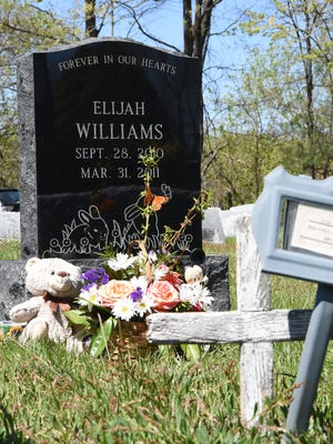 The gravestone of Elijah Williams behind the original grave marker placed by the county at LaGrange Rural Cemetery in the Town of LaGrange on Wednesday.