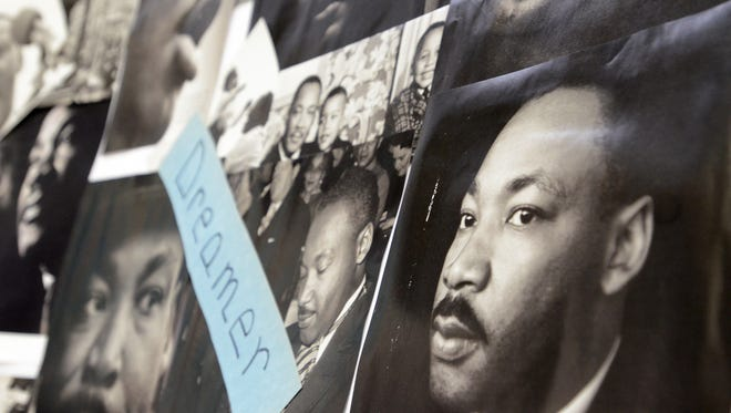Photos on display during the Martin Luther King, Jr. Day celebration last year in Milford