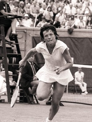 Billie Jean King chases down a shot during her semifinal match against Chris Evert at the 1971 U.S. Open. King won 12 Grand Slam singles titles, including six at Wimbledon.