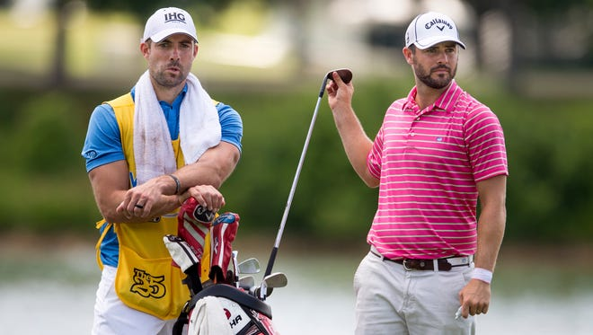 Wesley Bryan, right, takes his club from his caddie, Titans kicker Ryan Succop, left, on the first hole during the second round of the Web.com Nashville Golf Open on Friday at Nashville Golf and Athletic Club..
