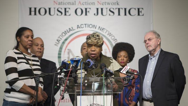 Gwen Carr, center, Eric Garner's mother, and Esaw Garner,