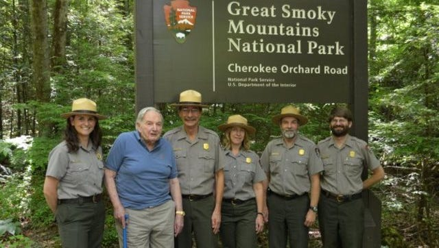 David Rockefeller Sr., second from left, pauses with National Park Service rangers during a May 31, 2013, visit to the Great Smoky Mountains National Park. Pictured are park spokeswoman Molly Schroer, left, Rockefeller, Superintendent Dale Ditmanson, park entomologist Becky Nichols, Chief of Resource Management and Science Jeff Troutman, and Park Museum Curator John McDade.