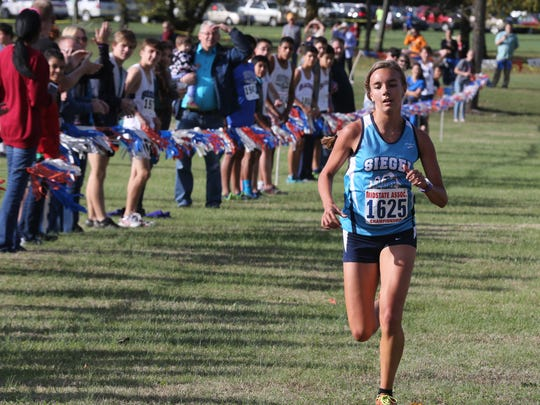 Siegel's Victoria Simmons won the Region 4-AAA girls cross country race on Thursday.