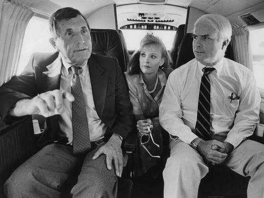 John McCain (right) sits with his wife, Cindy, and