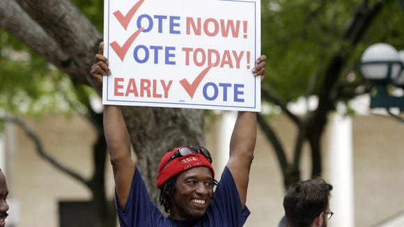 In Florida in October, James Sims encourages early voting in Miami. The state Senate plans to vote today on bringing an early voting program to New Jersey. (AP Photo/Lynne Sladky)
