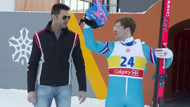 "Hugh Jackman and Taron Egerton star in the film ""Eddie the Eagle."""