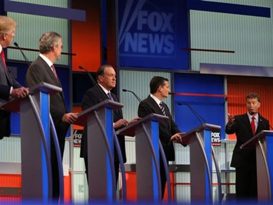Republican presidential candidates, from left, Donald Trump, Jeb Bush, Mike Huckabee, Ted Cruz and Rand Paul take the stage for the first Republican presidential debate at the Quicken Loans Arena Thursday, Aug. 6, 2015, in Cleveland.