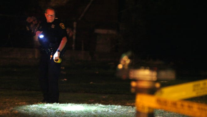 Police investigate a shooting in West End Monday night.