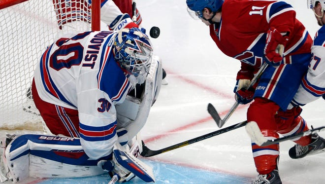Rangers goalie Henrik Lundqvist stops  Canadiens right wing Brendan Gallagher during the third period in Game 2 of the Eastern Conference final  Monday night.