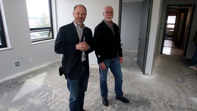 Critical Informatics CEO Garrett Silver, left, and founder Michael Hamilton stand in the company's Fourth Street offices, which were under renovation last week.