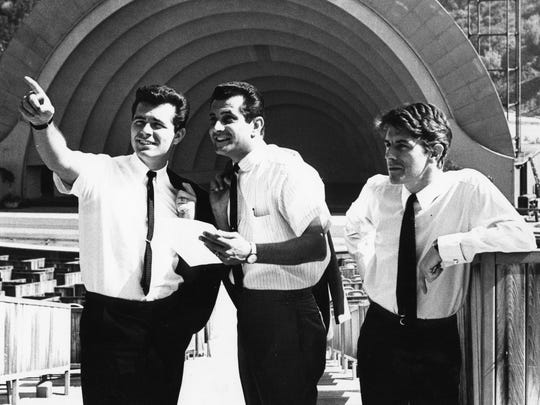 Bob Eubanks, Dave Hull (KRLA), and Derek Taylor (Beatles publicist) photographed at the Hollywood Bowl in 1964.