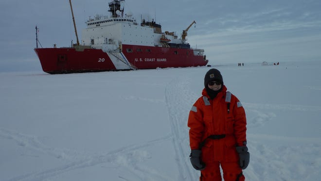 Southern Miss graduate student Laura Whitmore at the North Pole, in front of the U.S. Coast Guard Cutter Healy.