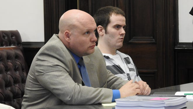Nathan D'Ostroph, right, of Coshocton, will stand trial next year on a murder charge in the September 2015 death of a 7-month-old girl he was babysitting. He is being represented by attorney Dan Guinn, left, of New Philadelphia.