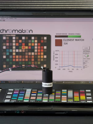 A Chromation color checker probe, which measures the color it's placed or focused on. Chromation is using nanotechnology to develop low-cost, high-quality light-measuring devices.