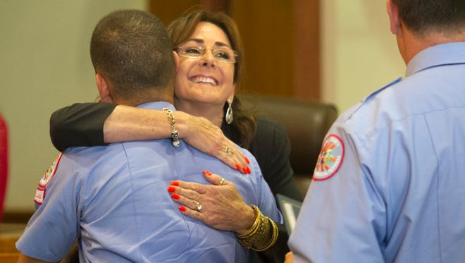 Darlene Croon hugs Daniel Blandon of Lee County EMS during the Phoenix Awards on Friday in Fort Myers. Blandon saved Croon's mother Janita. The Phoenix Award is presented to emergency responders who use resuscitate a patient in cadiac arrest. Paramedics and Emergency Medical Technicians from Lee County EMS, as well as county communication officers and local firefighters, received awards in the ceremony. Blandon got two Phoenix Awards on Friday.