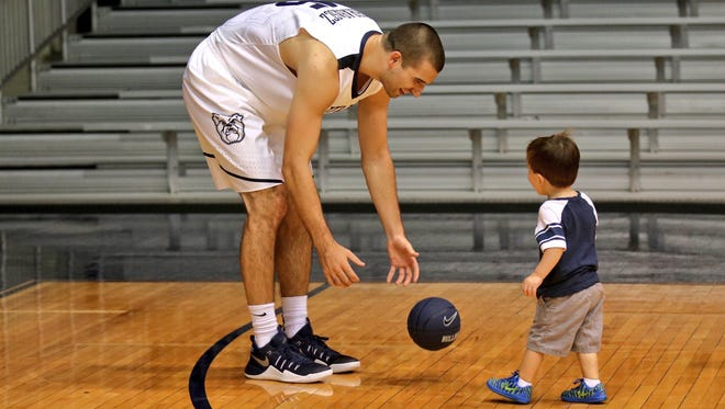 Butler basketball player Andrew Chrabascz plays with Miles Kaltenmark, 2.