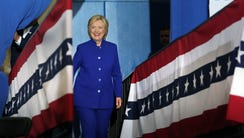 Hillary Clinton takes the stage during a campaign stop