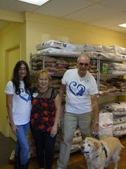 Volunteer Judy Udell with Cookie and Ted Pankiewicz Sr. and Libby, a For the Love of Paws rescue dog.