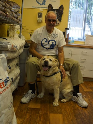 Ted Pankiewicz Sr.  with For the Love of Paws rescue dog and blind mascot 'Libby.'