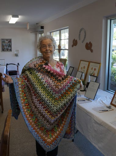 """Venice Powell, resident, displays her donated """"every"""