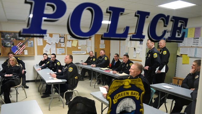 Green Bay police officers gather for a briefing.