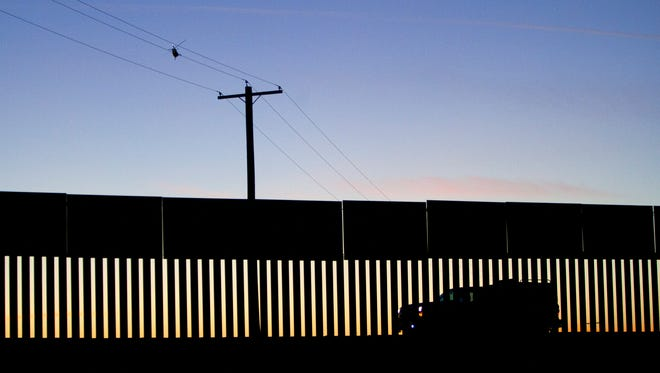 U.S. Border Patrol agents search by air and ground along the fence marking the border between the United States and Mexico.