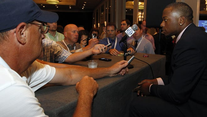 Mississippi defensive end CJ Johnson speaks to media at the Southeastern Conference NCAA college football media days on Thursday, July 17, 2014, in Hoover, Ala. (AP Photo/Butch Dill)