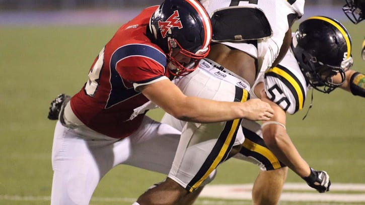 West Monroe LB John Bailey Gullatt takes down Neville ball carrier in Friday night jamboree action at Don Shows Field at Rebel Stadium.
