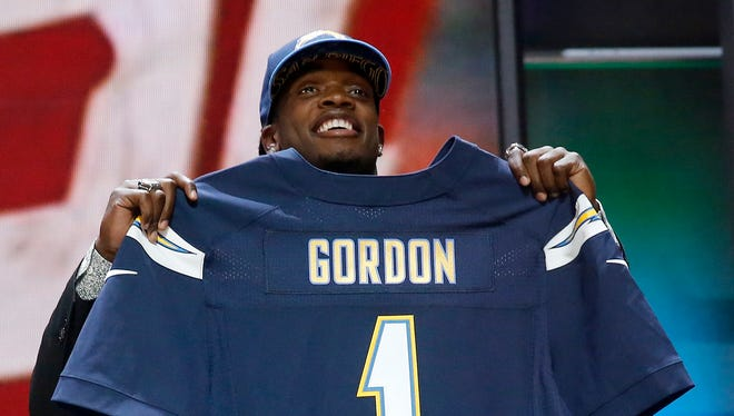 Wisconsin running back Melvin Gordon poses for photos after being selected by the San Diego Chargers as the 15th pick in the first round of the 2015 NFL Draft.