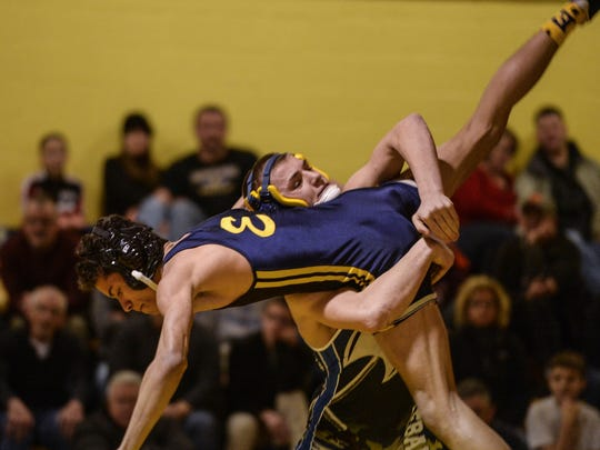Northern Lebanon's Steve Herb brings Elco's Austin Eldridge to the mat earlier this year. Herb gained a No. 1 seed and Eldridge a No. 4 seed for their sectional tournaments on Saturday.