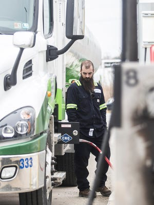 Shipley Energy Transport Driver Ethan Miller, of West Manchester Township, fuels up on 90 gallons of CNG for the companies 18 wheeler, at Pacific Pride Thursday, March 30, 2017. Amanda J. Cain photo