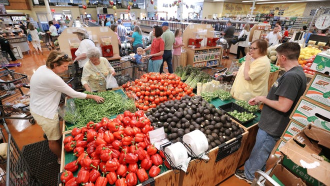 The opening of Fresh Thyme Farmers Market in Greenwood drew a crowd to check out the new store on June 12, 2014.