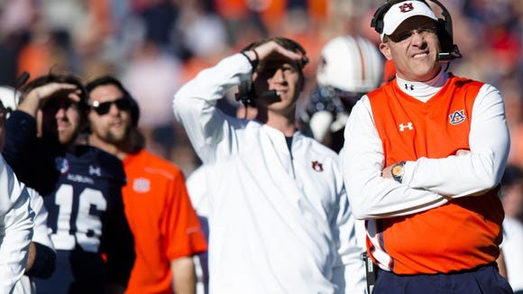 Auburn Tigers head coach Gus Malzahn looks on during the the NCAA football game between Auburn Tigers and Georgia on Saturday, Nov. 14, 2015, in Auburn, Ala. Georgia defeated Auburn Tigers 20-13.
