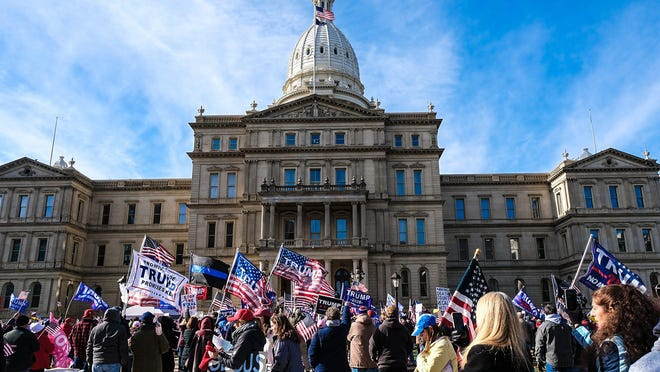 """Supporters of President Donald Trump attend a """"Stop the Steal"""" rally at the Capitol in Lansing Saturday, Nov. 14, 2020."""