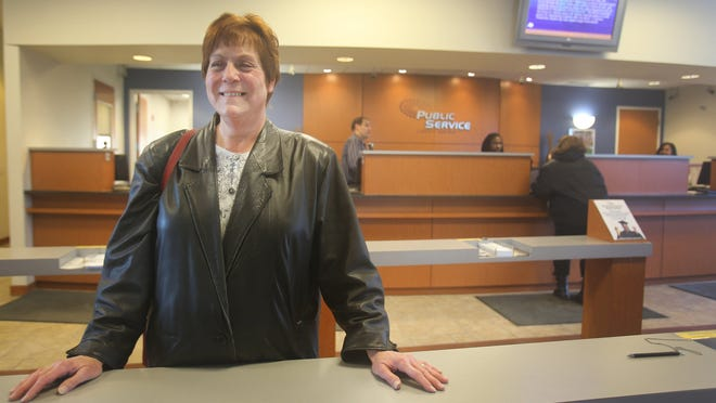 The Public Service Credit Union surprised Odette Ferguson of Romulus with a $25 gift card Friday as she stood in line taking care of her banking.