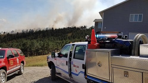 Emergency crews on Wednesday afternoon responded to reports of a wildland fire burning near structures south of Carter Lake, west of Berthoud, in Larimer County.