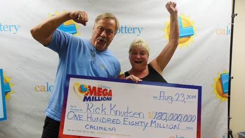 $180 million Mega Millions winner Rick Knudsen of Calimesa and his wife Lorie at the California Lottery Inland Empire District Office in San Bernardino on Wednesday, Sept. 3, 2014.