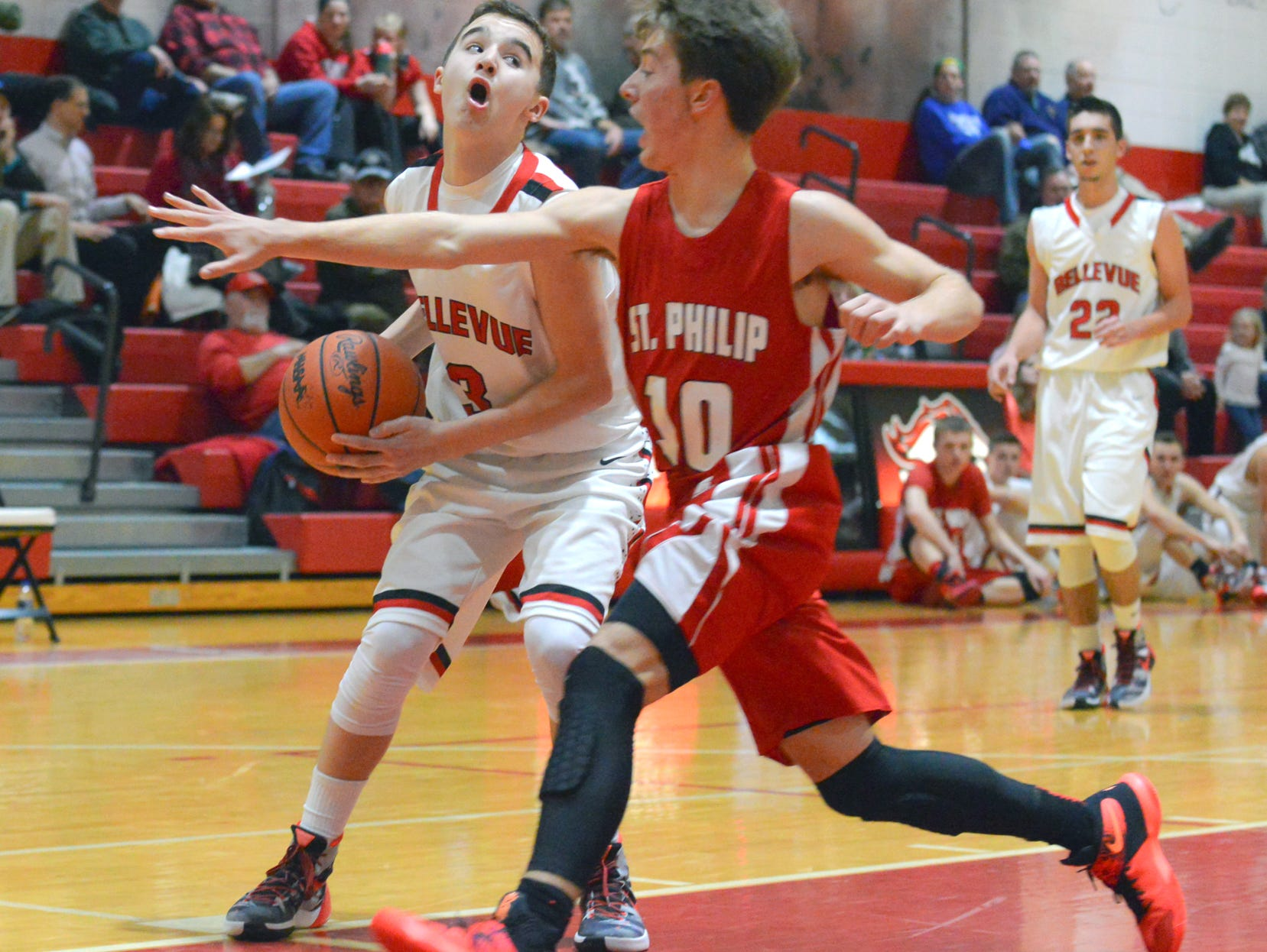 Bellevue's Gino Costello drives the basket Friday night.